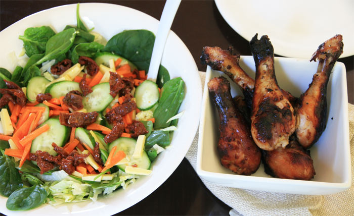 Marinated chicken drumsticks and salad